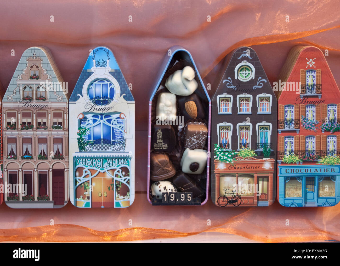 chocolate tins of Buildings in Bruges - Stock Image