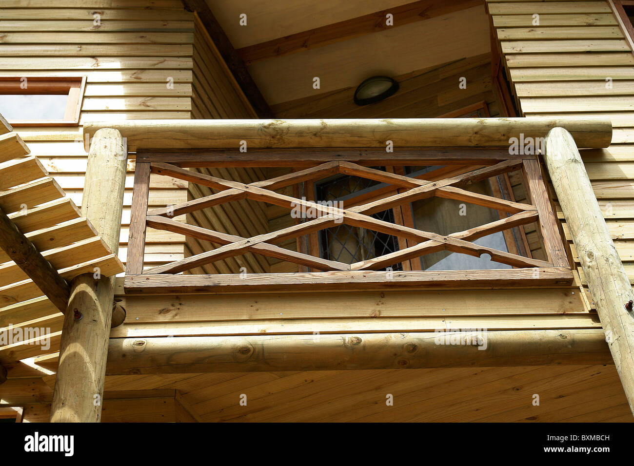 Balcony with handrail of wood, foreground to highlight the wood and the way. - Stock Image