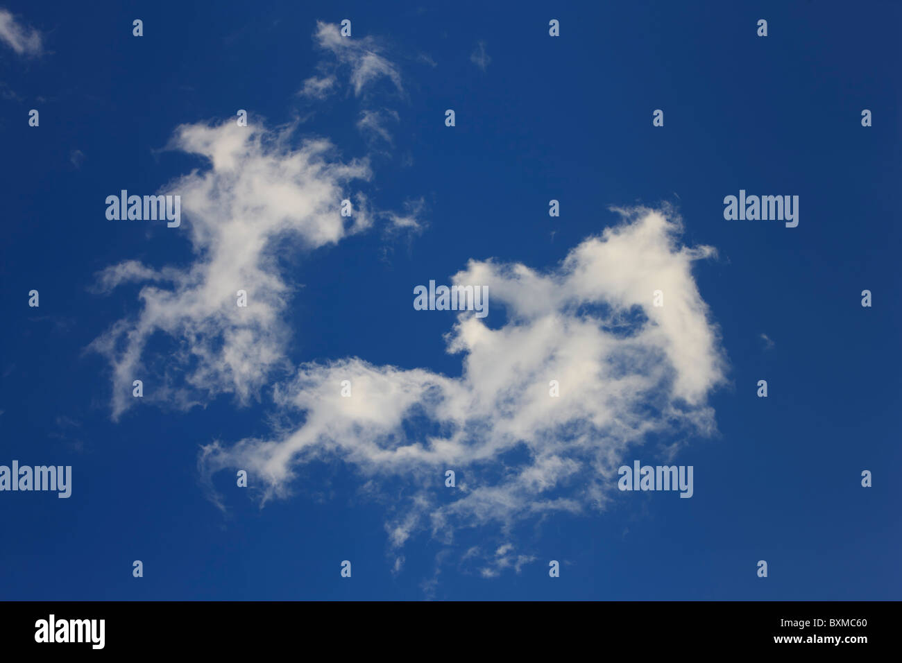 Some wispy clouds that are dissipating overhead. Stock Photo