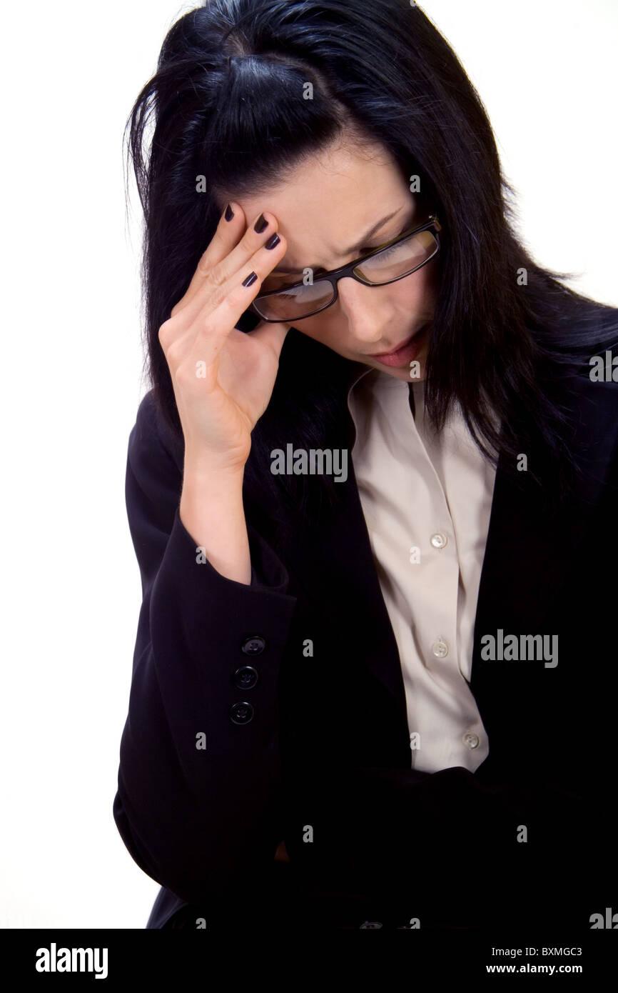 Woman having a headache - Stock Image