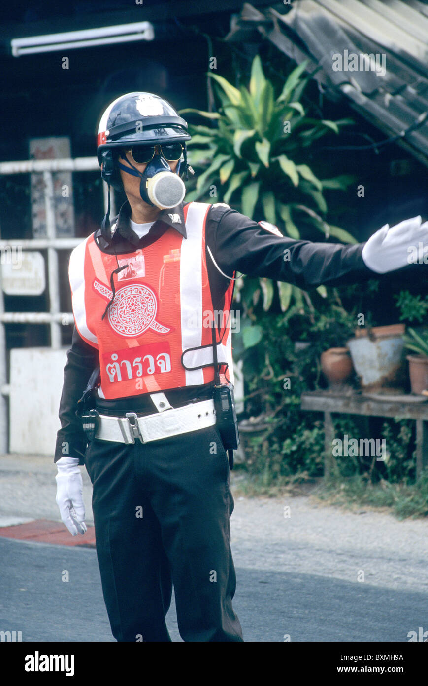 Officer, wearing respirator, - Stock Image