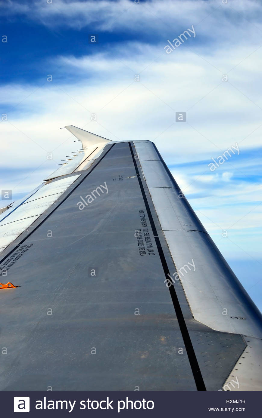 detail of the wing of an airplane in flight - Stock Image
