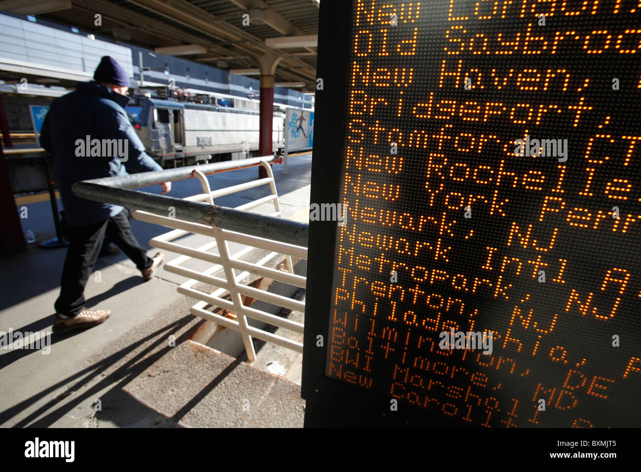 A person heads towards a train, South Station, Boston, Massachusetts - Stock Image