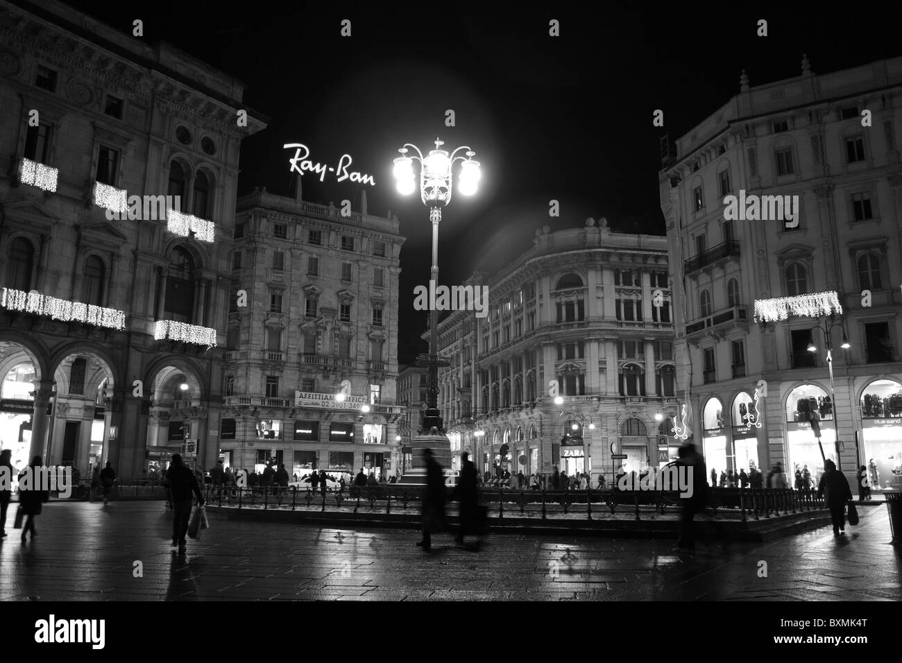 It was mid of December, few days remaining before Christmas, and people where passing by in the Duomo Square with - Stock Image