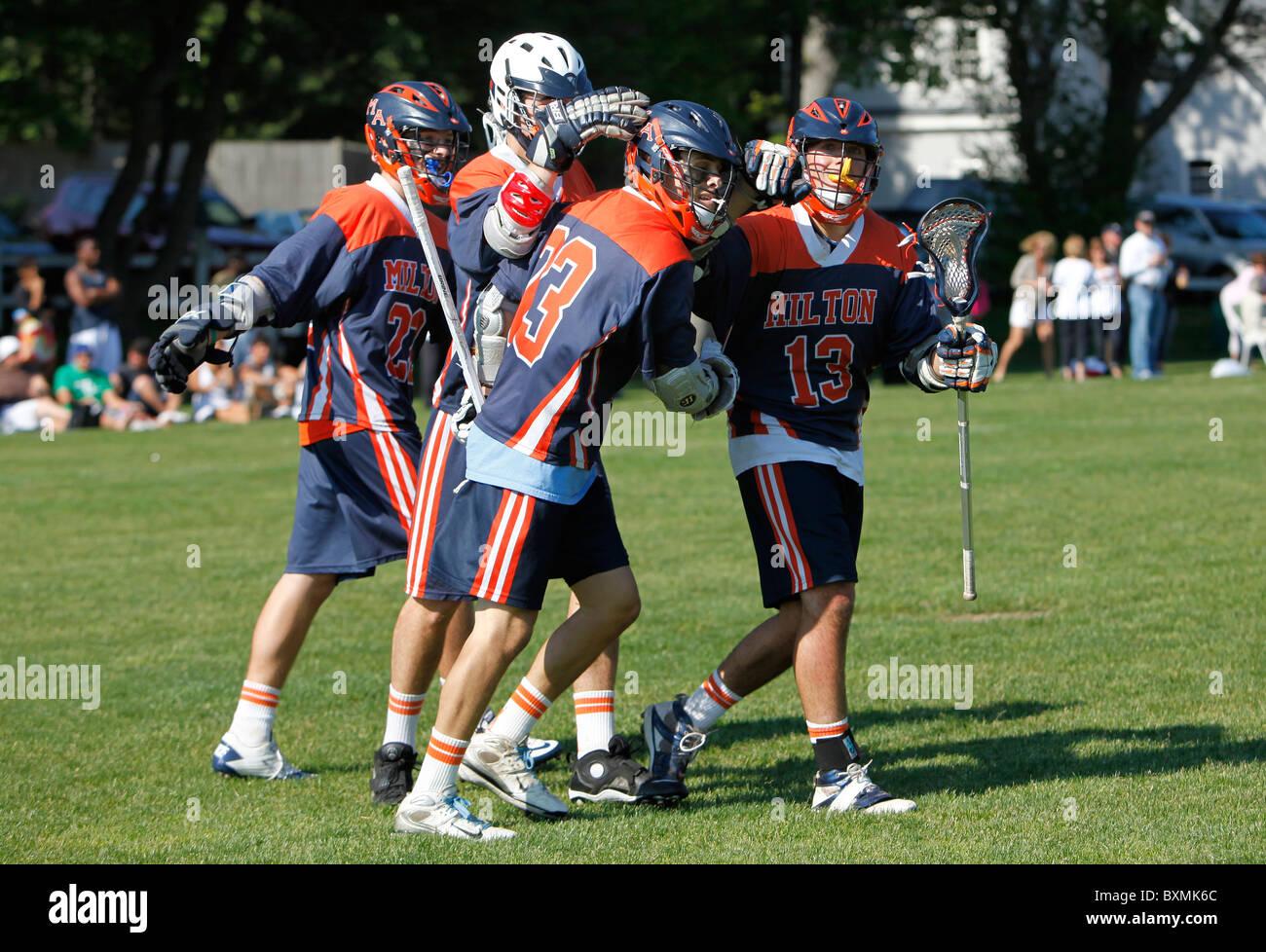 American high school lacrosse team celebrates after scoring - Stock Image