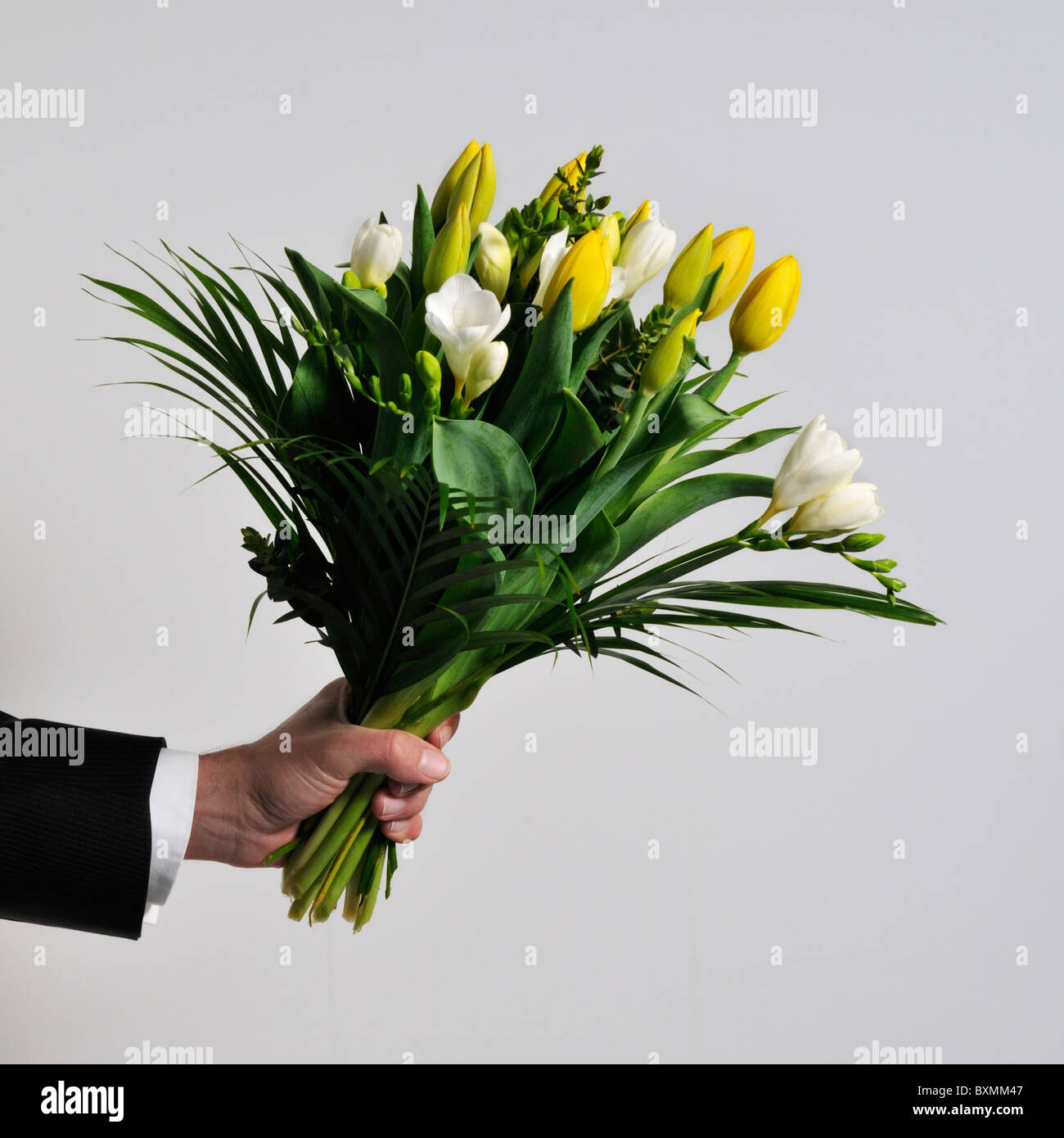 bunch of flower with male hand - Stock Image