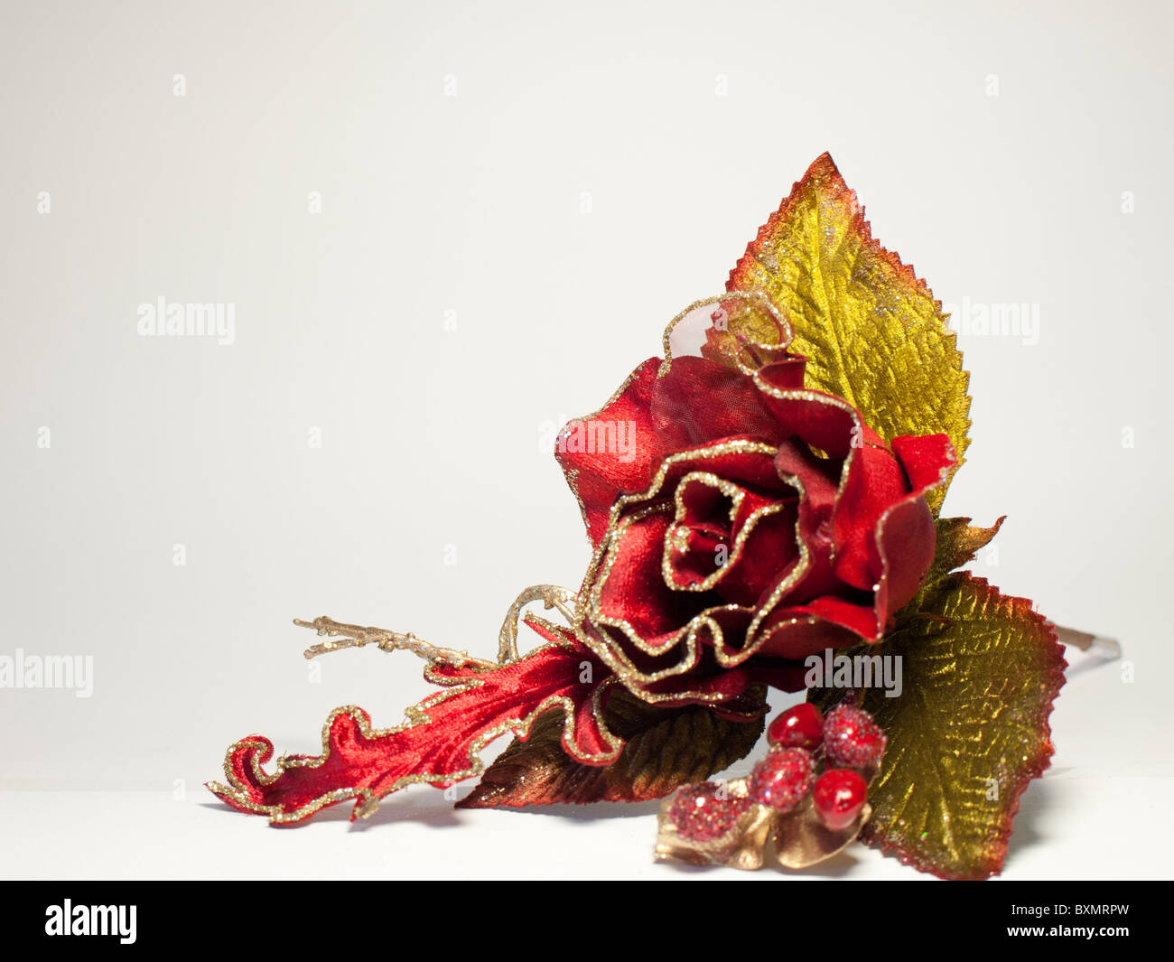 Artificial silk christmas flower red rose - Stock Image