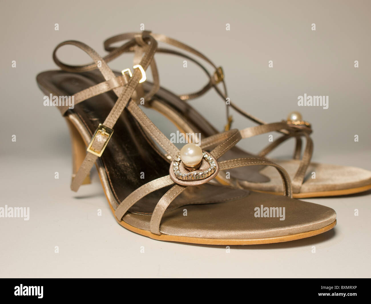 Idea for comfy wedding shoe, the brown satin wedding shoes with pearl. - Stock Image