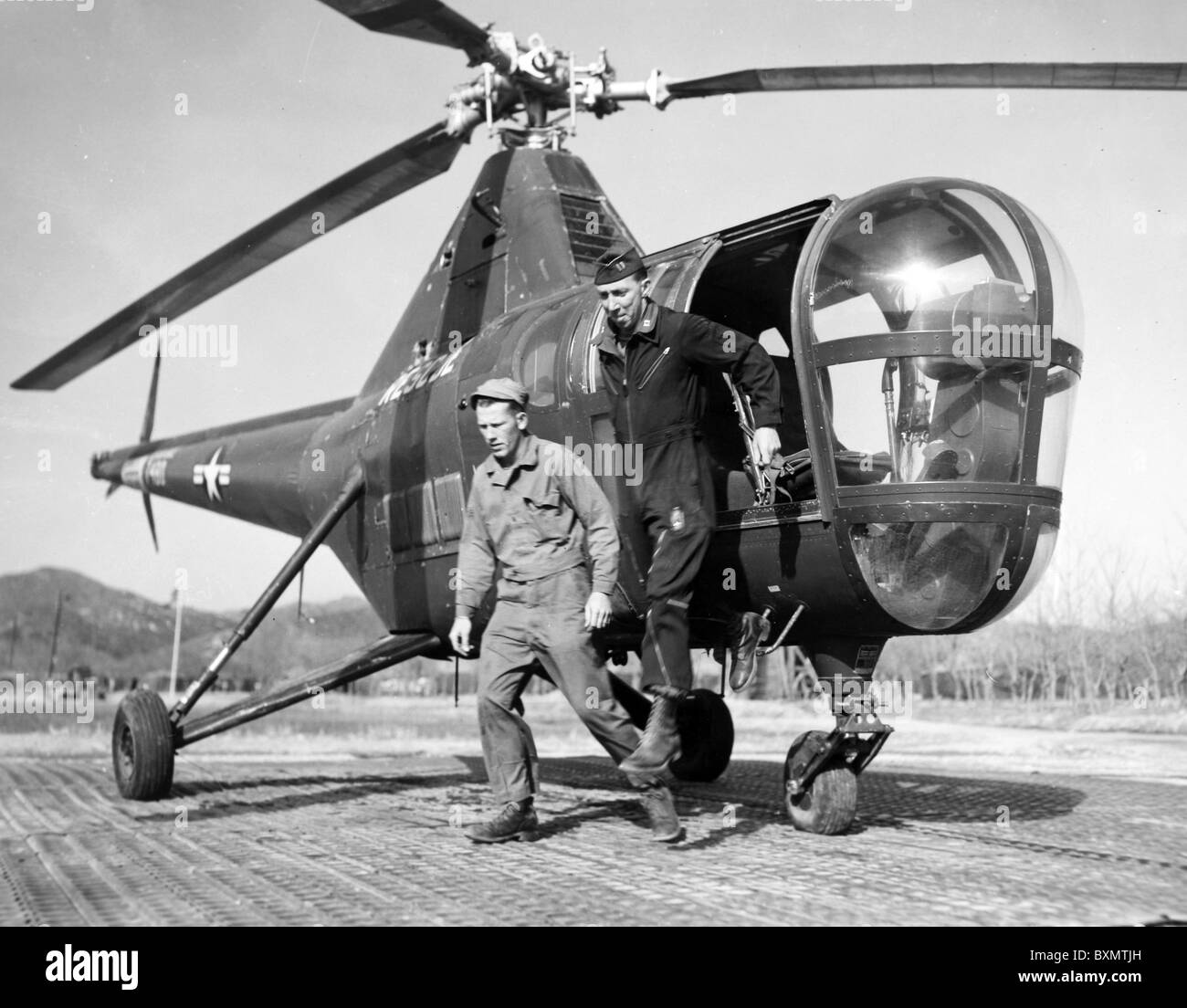 The 3rd Air Rescue Squadron crew that flew delegates to Panmunjon, Korea for prisoner exchange talks are A/2C Roger - Stock Image