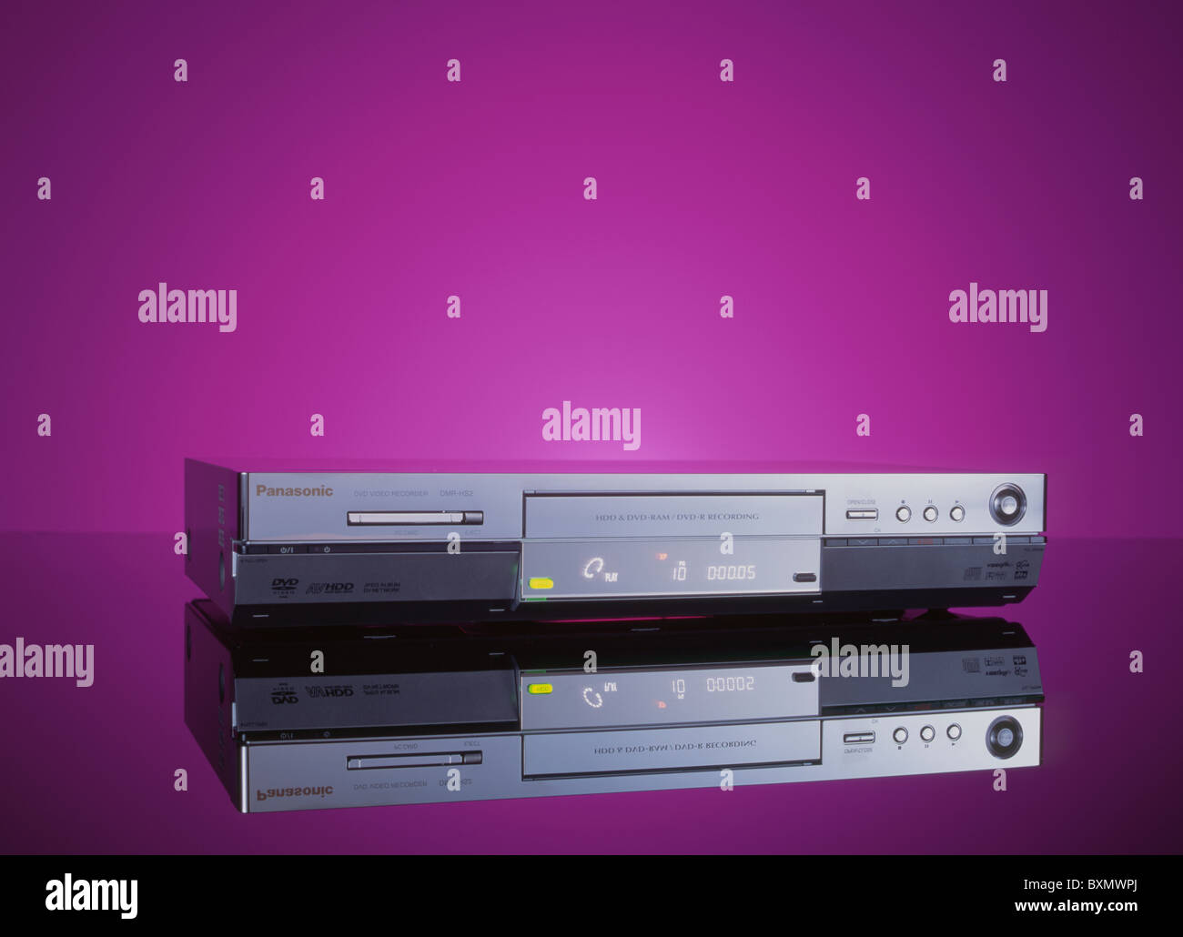 Panasonic DVD video recorder against a purple background - Stock Image