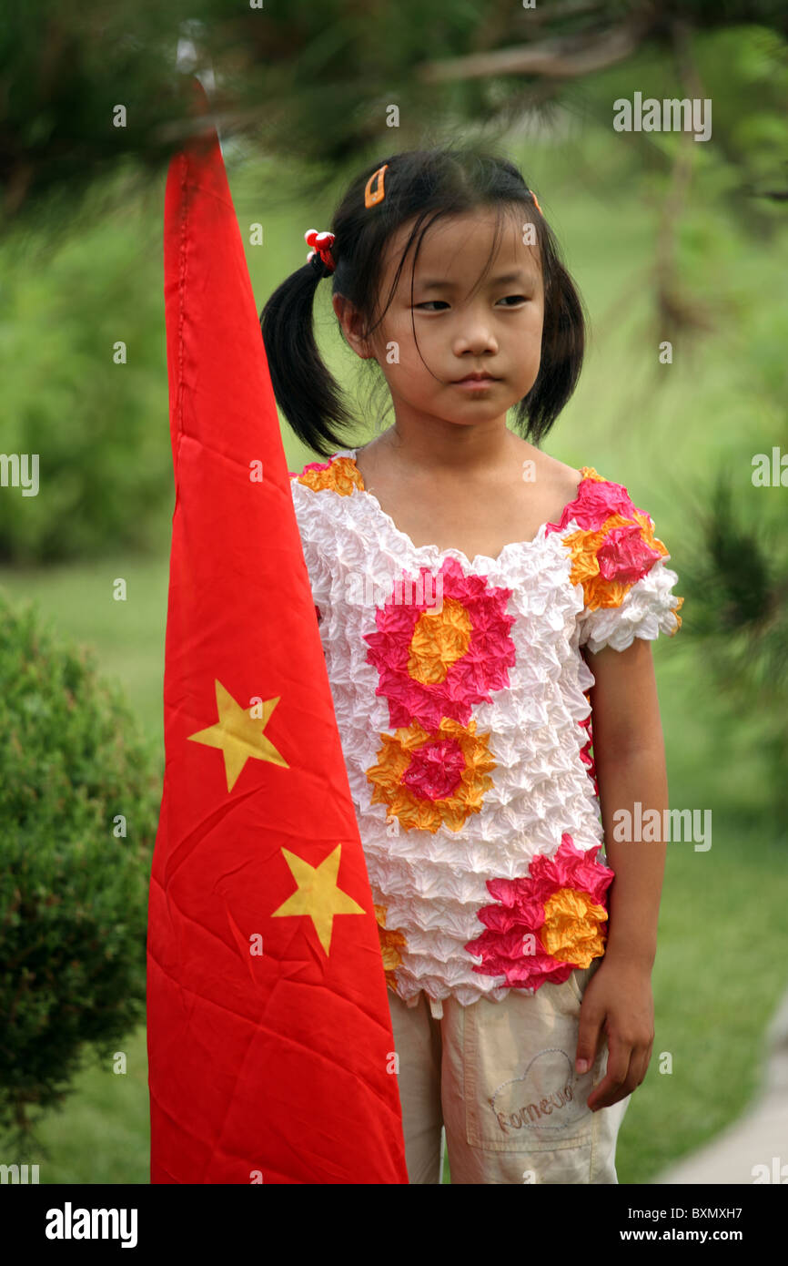 Chinese girl with national flag, Olympic Games, Beijing, China - Stock Image