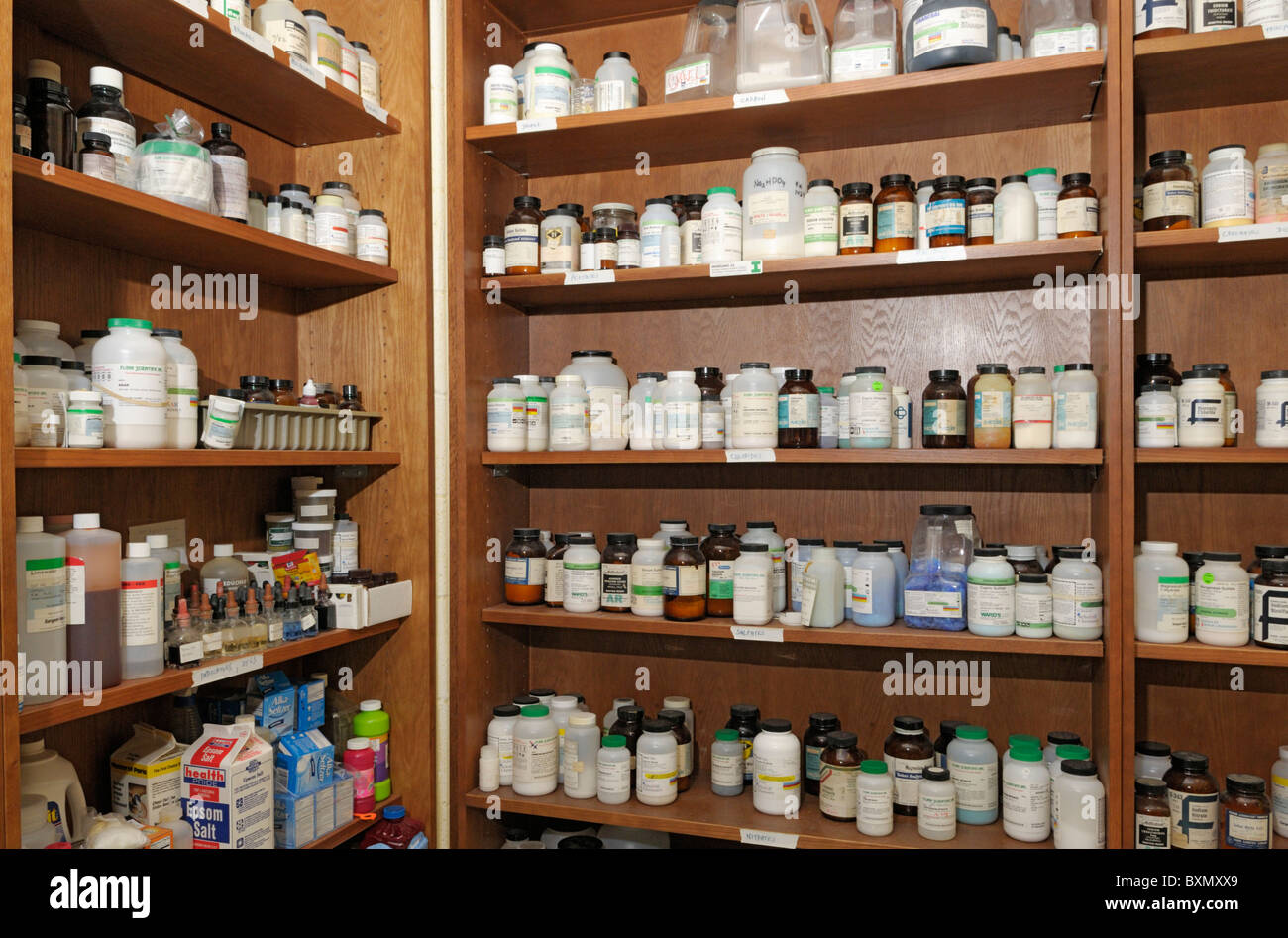 Chemical storage for a high school chemistry laboratory - Stock Image