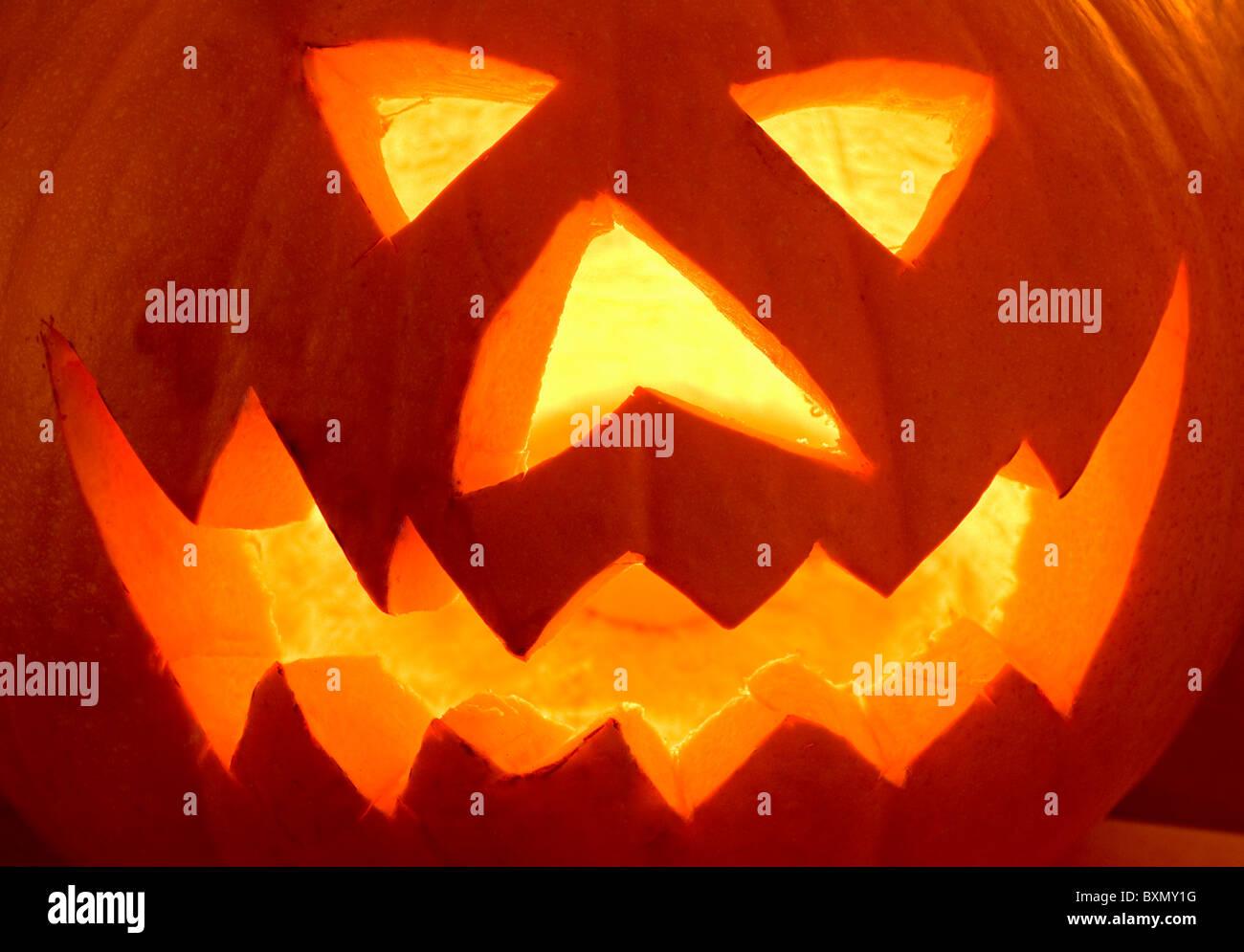 Illuminated Scary Halloween Pumpkin Face - Stock Image
