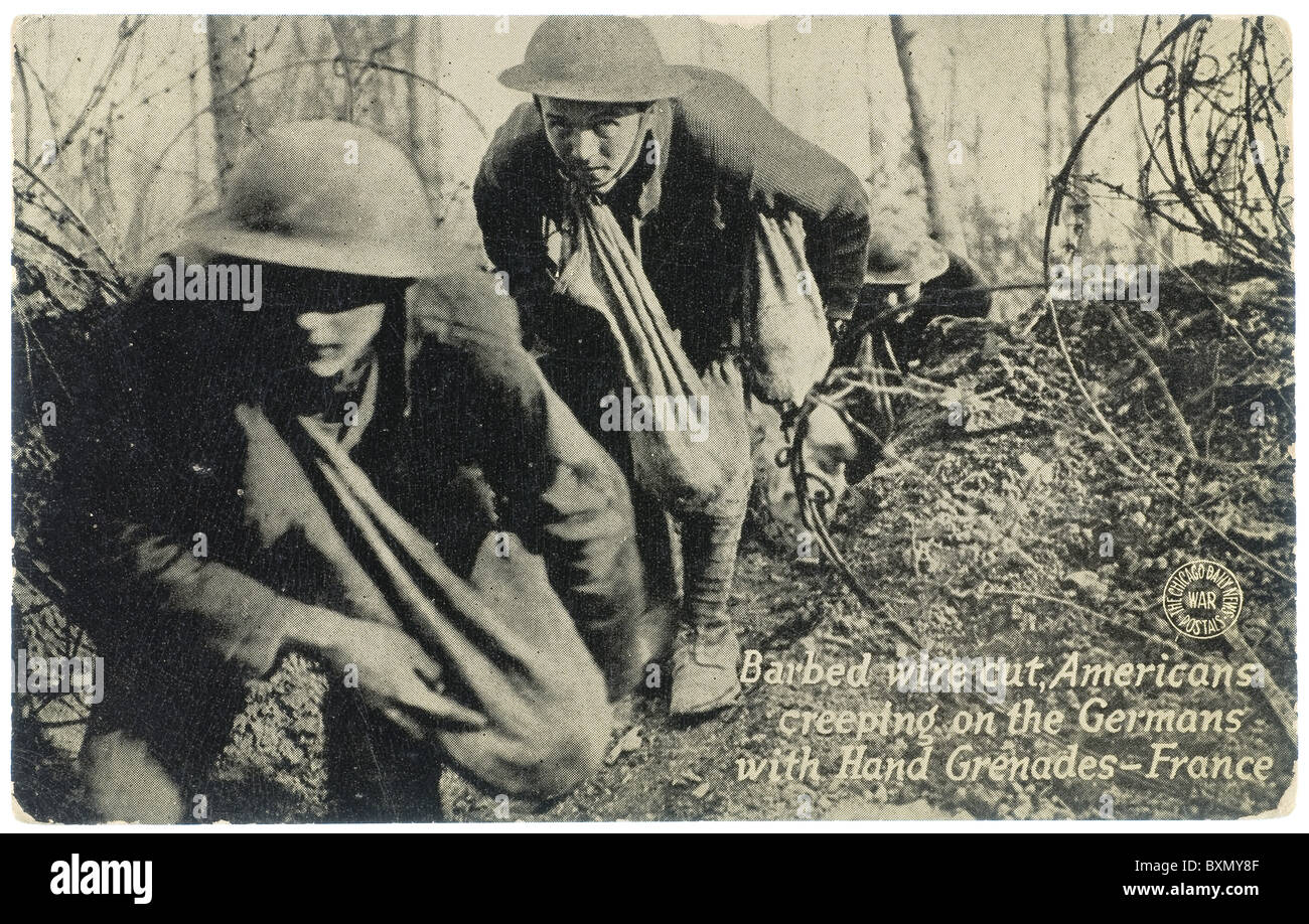 Barbed wire cut Americans creeping on the Germans with hand grenades, France, post card from Chicago Daily News, - Stock Image