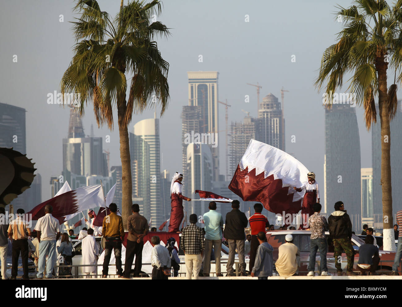 Qataris on their cars wave the flag on the Corniche road in Doha, Qatar, on National Day, December 18, 2010. Expats Stock Photo