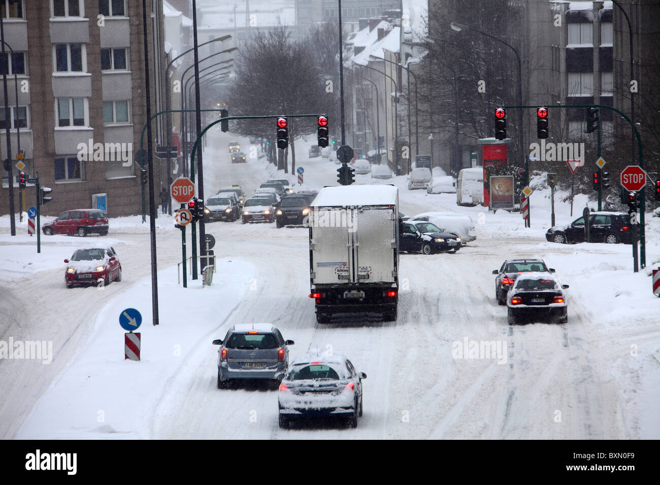Wintertime, traffic in a city center, snow covered streets. - Stock Image