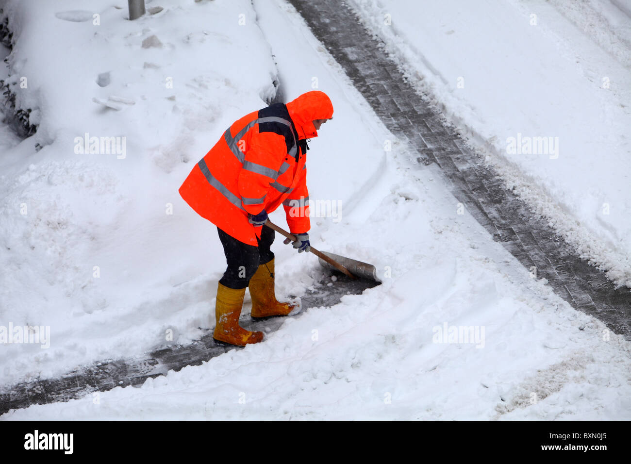 Wintertime, street and walkway cleaning, snow and ice control, winter service. - Stock Image