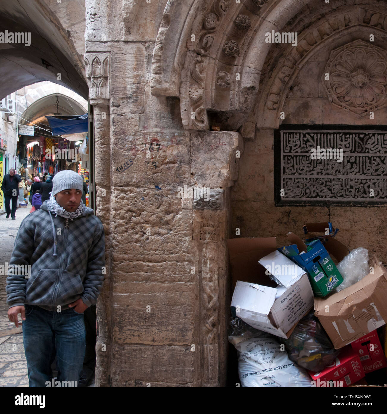 palestinian youngster next to previous Mameluk fountain. Jerusalem Old City - Stock Image