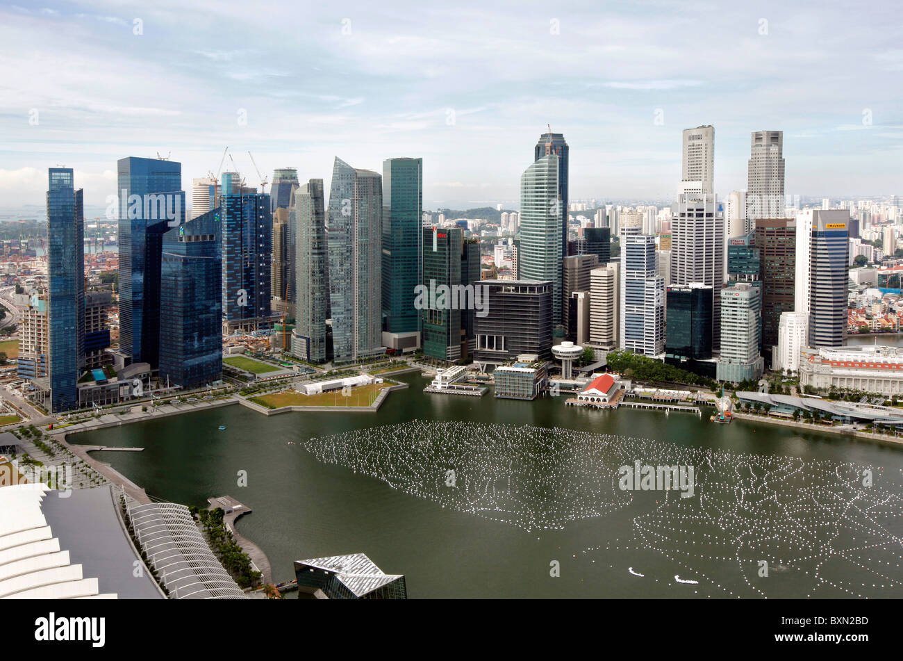 Singapore Marina Bay and skyline of the financial district view from top of Marina Bay Sands Hotel - Stock Image