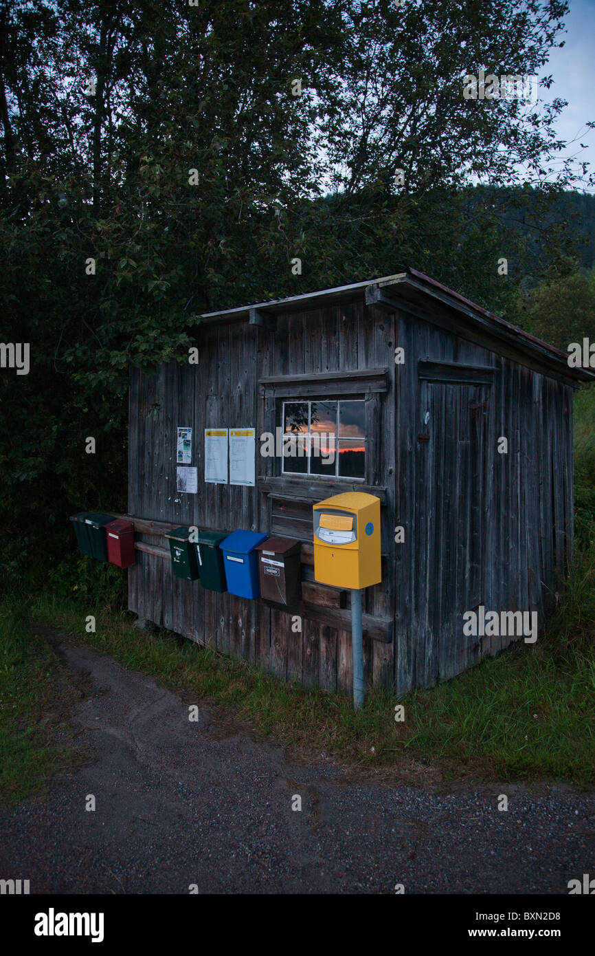 Shed with letter boxes and post box on a summer night in Varmland, Sweden. - Stock Image