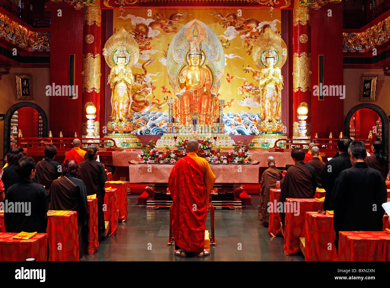 Singapore, prayer inside Buddha Tooth Relic Temple - Stock Image