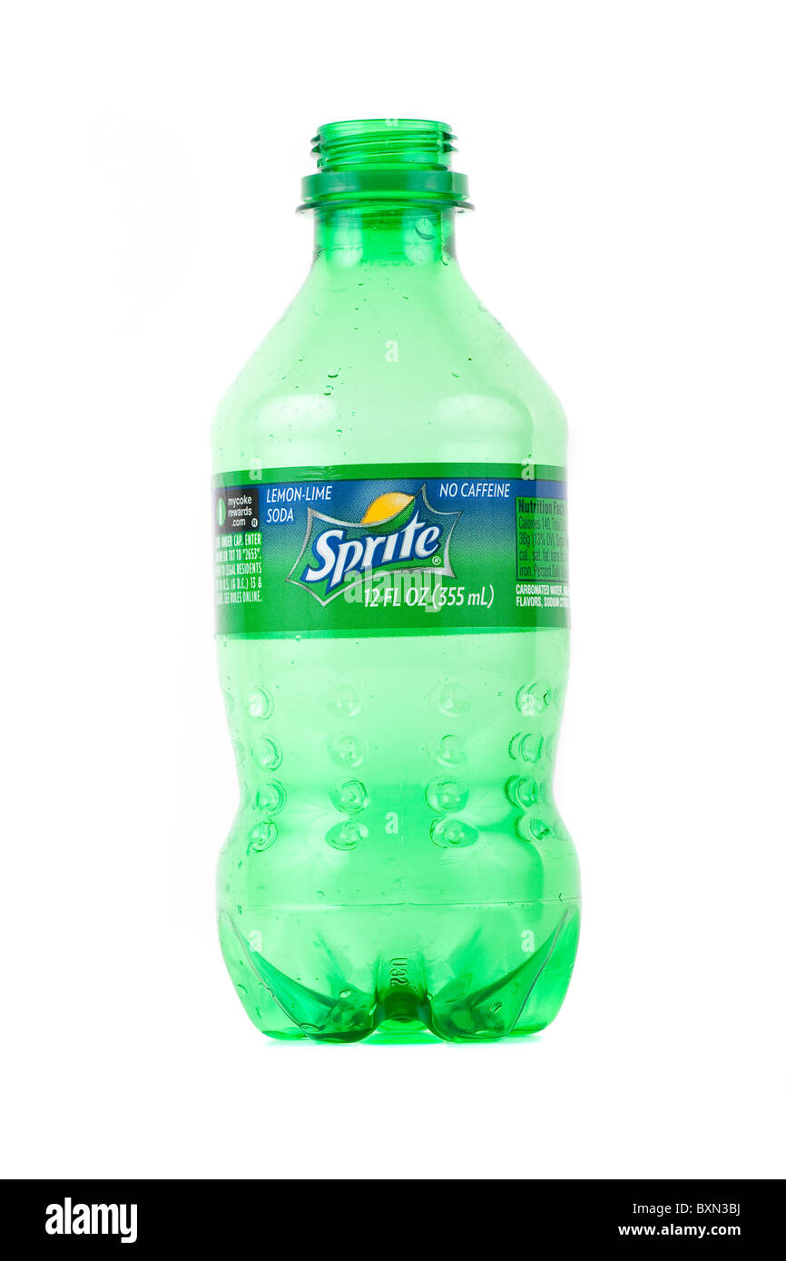 An empty plastic Sprite bottle on a white background - Stock Image