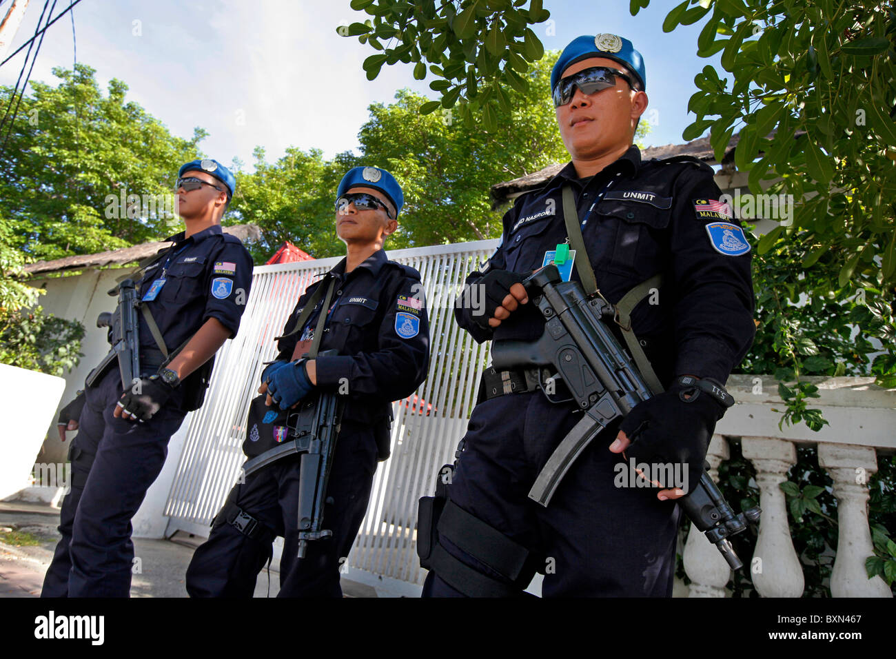 UN multinational Peace Keepers from Malaysia guarding the gate of the prime ministers home. Dili, Timor Leste (East - Stock Image