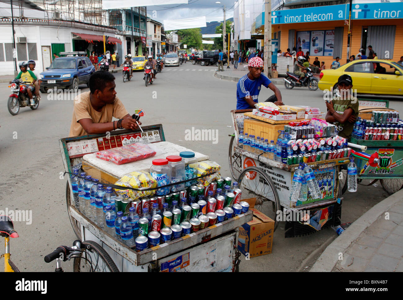 Trader on bicycle carts selling refreshments, Colmera commercial district of Dili capital of Timor Leste (East Timor) - Stock Image
