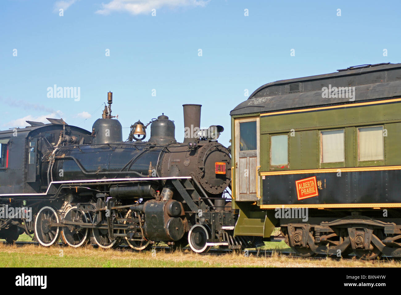 Steam Train Locomotive and Passenger car - Stock Image