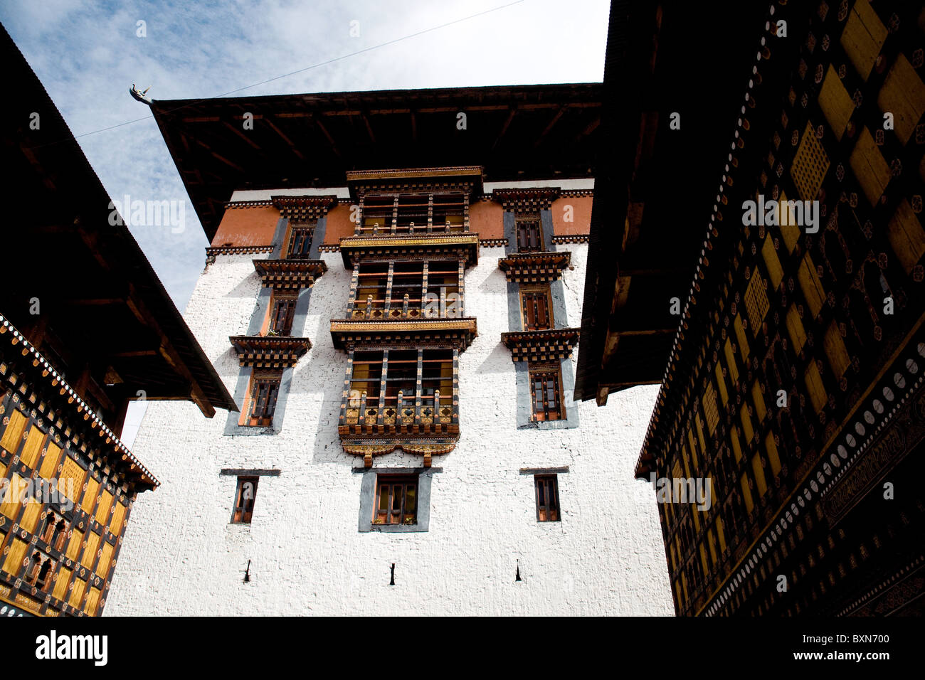looking up to the monks' area within the walls of the Paro dzong, or fortress, in Bhutan - Stock Image