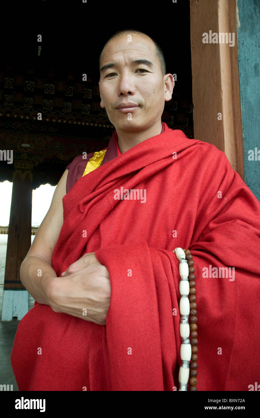 A senior Buddhist monk who is Master of Discipline to the monastic community in the Paro dzong, Bhutan - Stock Image