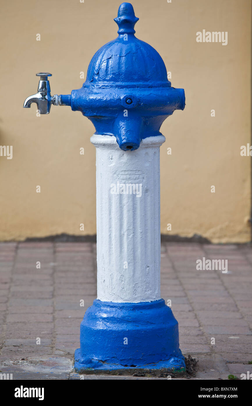 Blue and white drinking fountain water tap in Ardmore Village, County Waterford, Southern Ireland - Stock Image