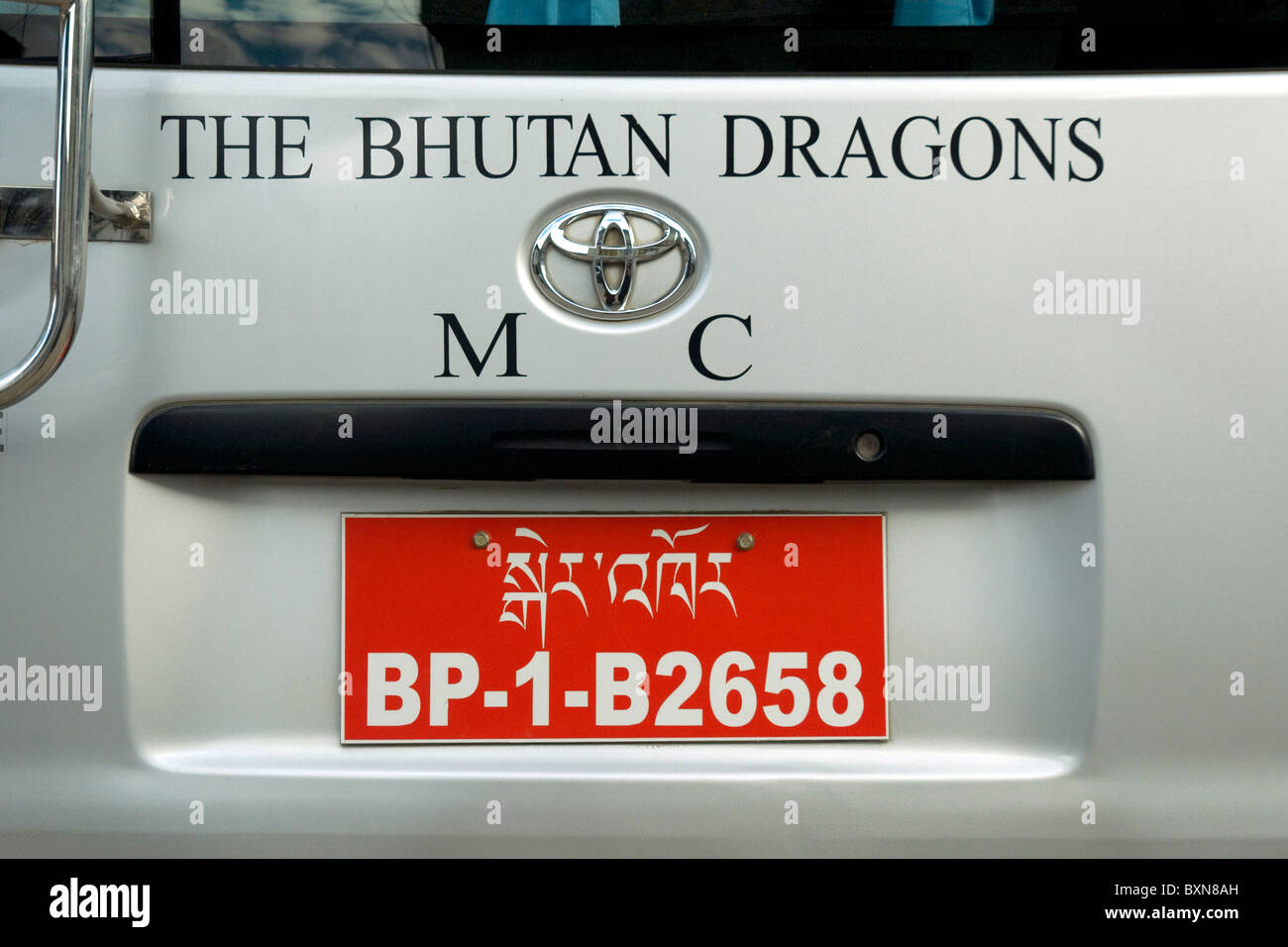 Dragons are Bhutan's national symbol but this car in a Paro street is promoting a local motor cycle club - Stock Image
