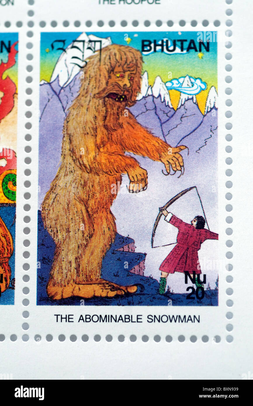A Bhutan postage stamp shows a yeti, or abominable snowman--which country folk  believe exists--along with an archer - Stock Image