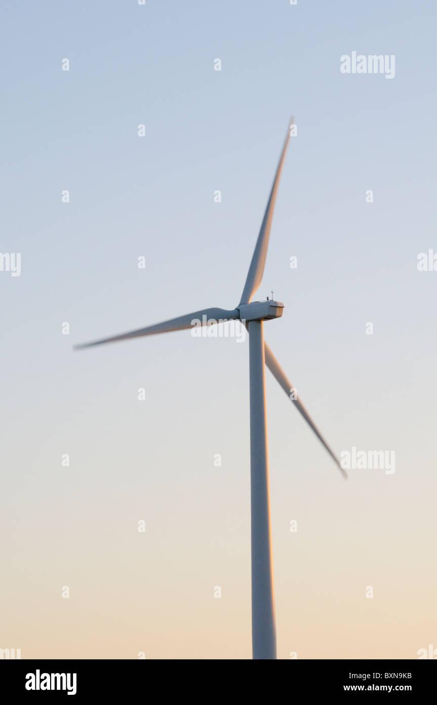 Wind turbine at dawn - Stock Image