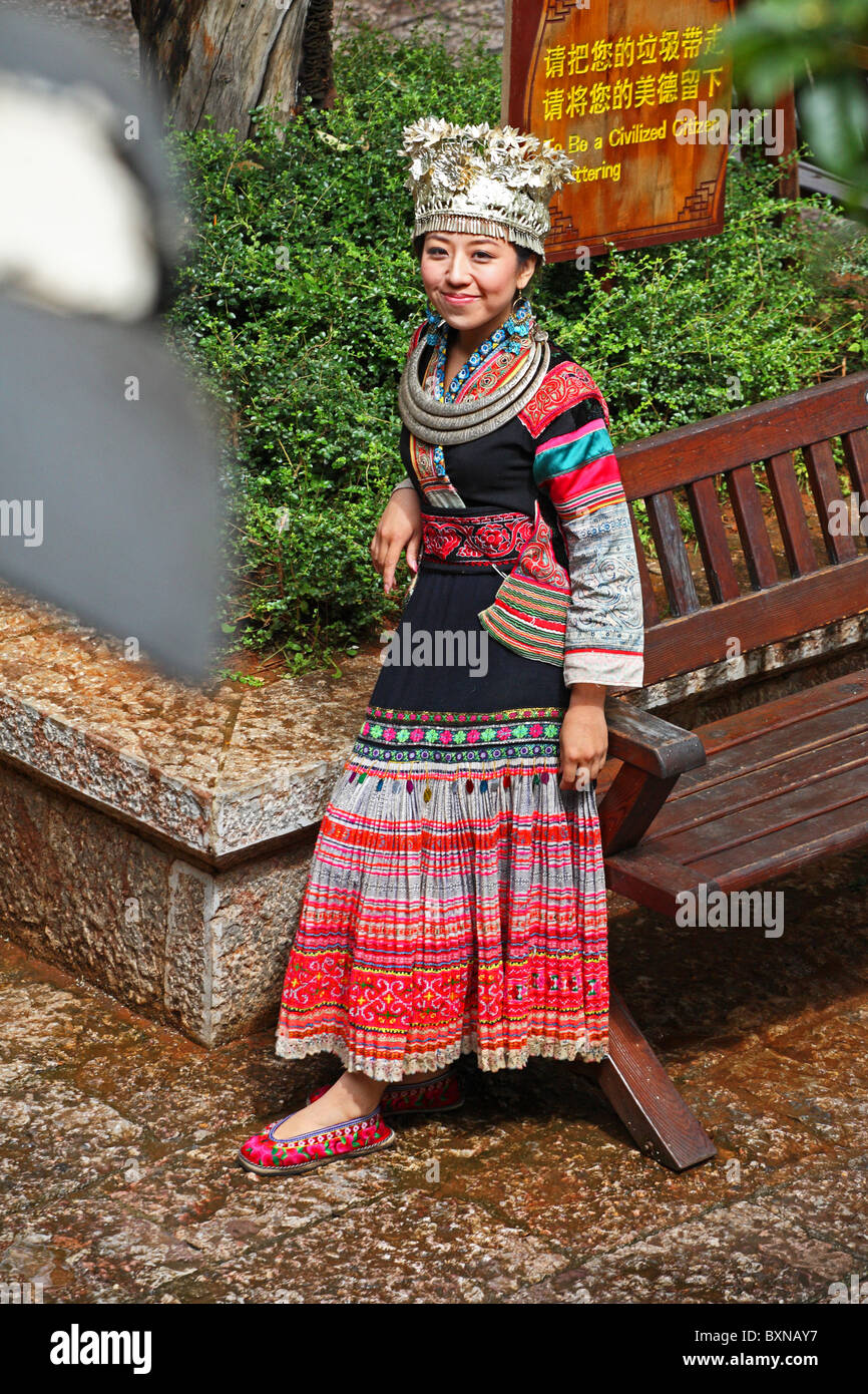 Female in traditional dress posing in Lijiang, Yunnan Province, China Stock Photo