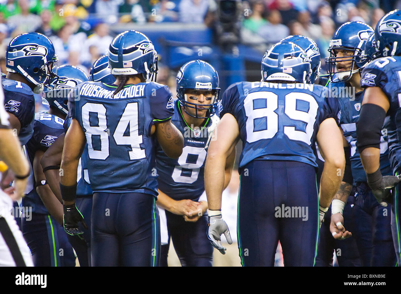 Seattle Seahawks Quarterback Matt Hasselbeck leading the huddle during an NFL football game - Stock Image