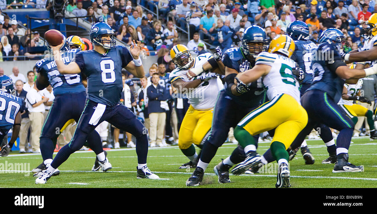 Matt Hasselbeck quarterback of the Seattle Seahawks throwing the football in an NFL game against the Green Bay Packers - Stock Image
