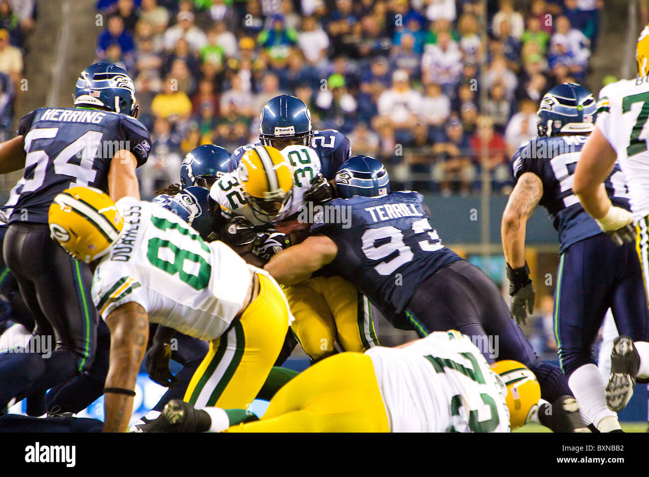 NFL teams the Seattle Seahawks and the Green Bay Packers playing a football game - Stock Image
