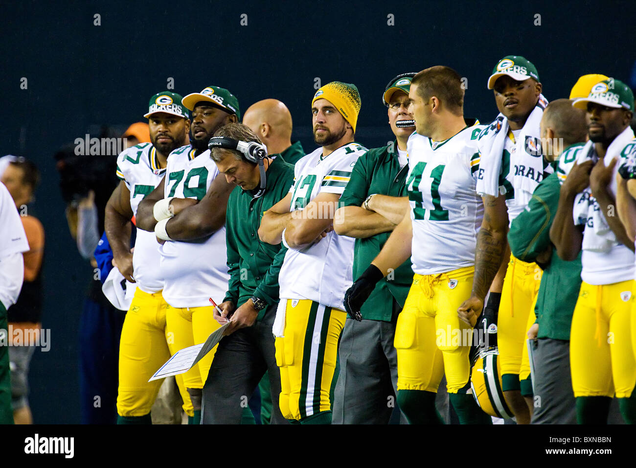 NFL Team Green Bay Packers standing on the sidelines during a football game - Stock Image