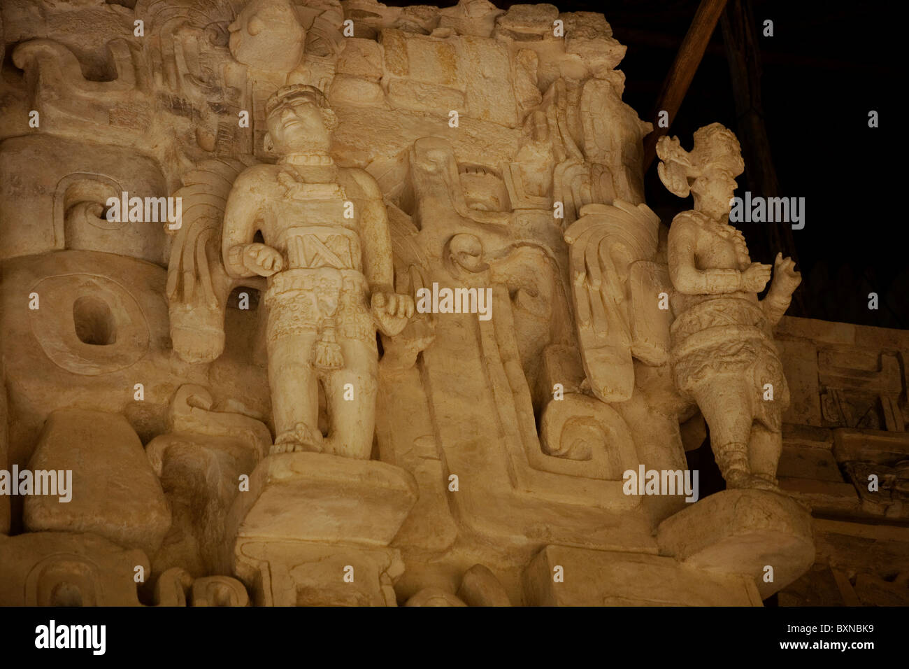 Stucco sculptures representing men with wings decorates a temple among the Mayan ruins of Ek Balam in Mexico's - Stock Image