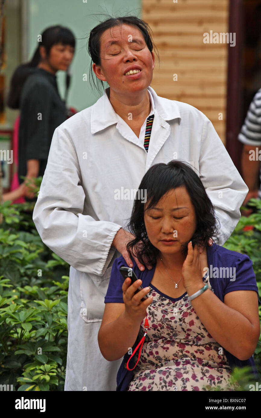 Blind Masseuse on the streets of Kunming, China Stock Photo