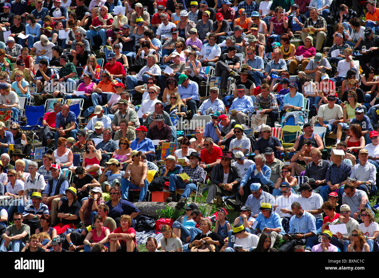 Sitting spectators of a public event on a summer day, crowd picture, Switzerland - Stock Image