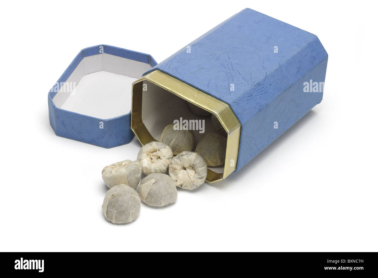 Chinese pressed tea blocks wrapped in paper and gift box ( Royal Pu erh Tuocha ) - Stock Image