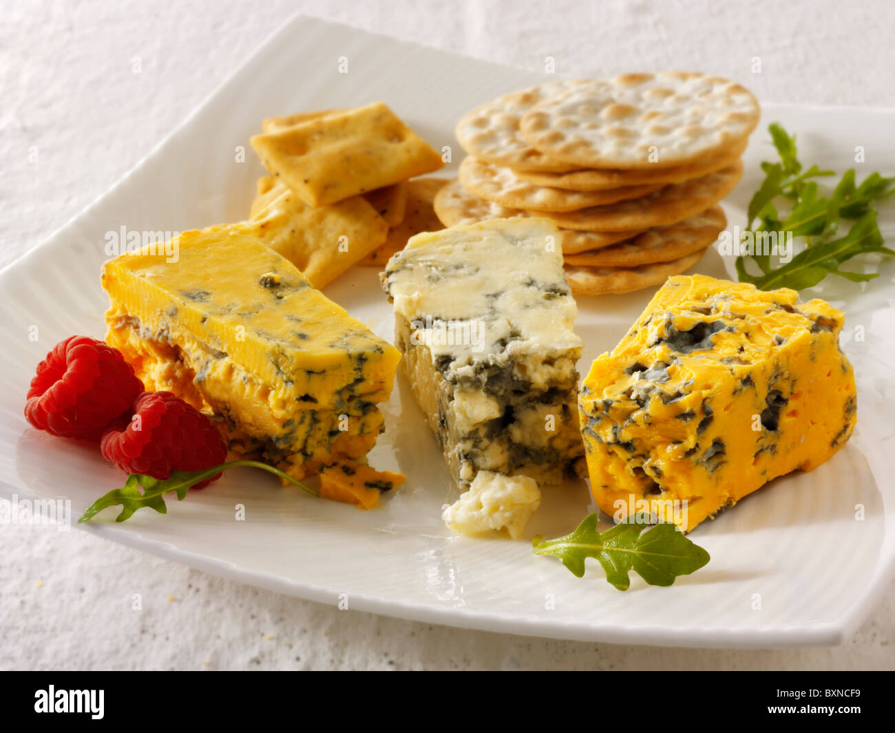 Cheese & biscuits with stilton, white stilton & blacksticks cheese. - Stock Image