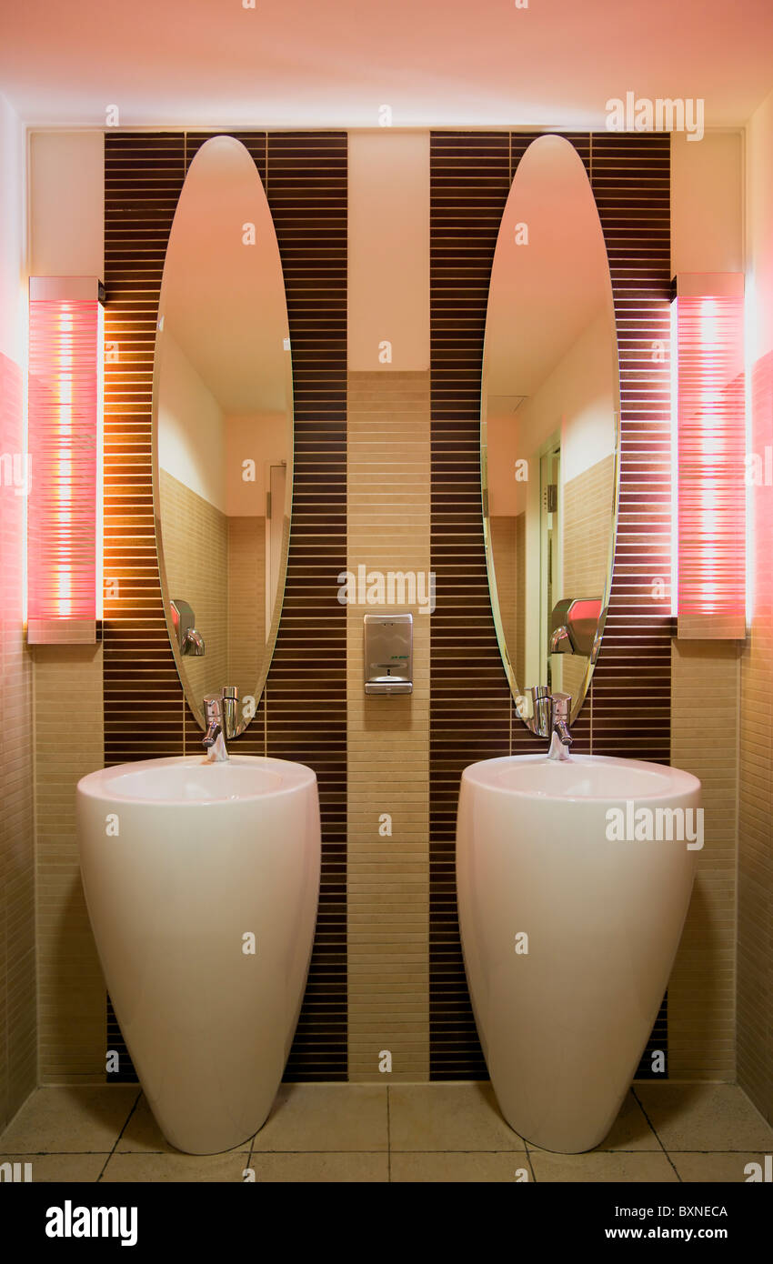 GERMANY, Saxony, Dresden, Washroom in restaurant with two washbasin sinks and matching mirrors. - Stock Image