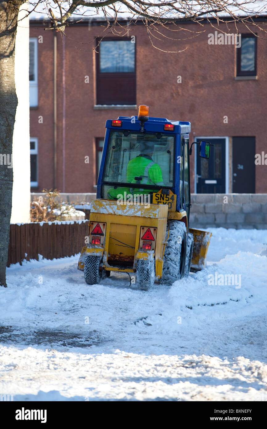 Council snow clearing operations.Montrose.Spreading grit and ploughing snow off pavements - Stock Image