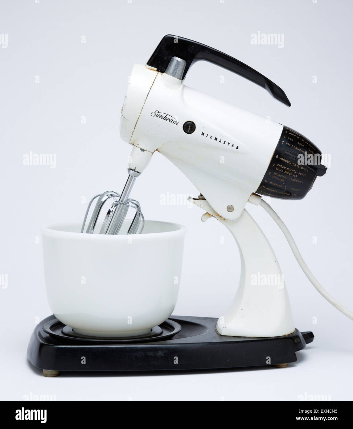 Food Preparation, Cooking, Kitchen Equipment, Sunbeam Mixmaster electric food blender or mixer circa 1953 on a white - Stock Image