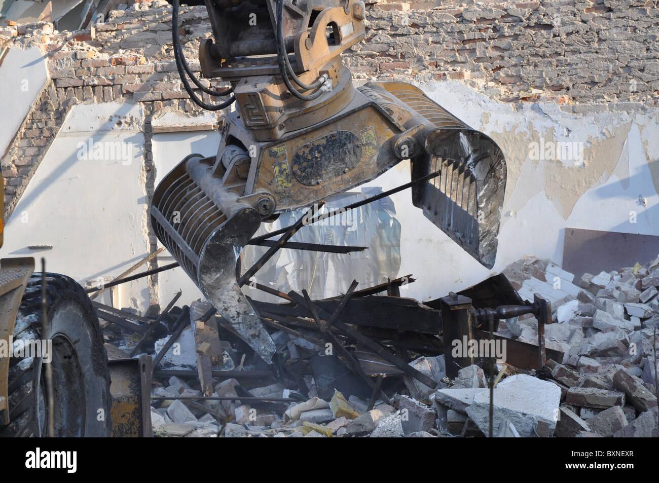 Demolition machine in action - Stock Image
