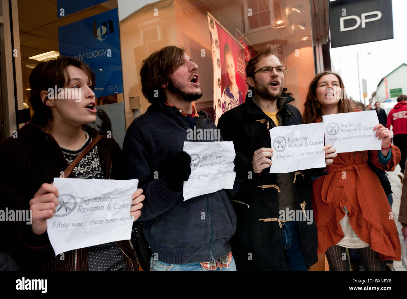 UK Uncut protesters demonstrating at a branch of Dorothy Perkins clothes shop protesting about tax avoidance by - Stock Image